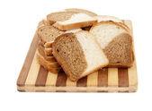 Sliced bread on a board — Stock Photo