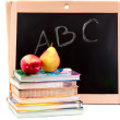Stock Photo: Blackboard and textbooks with fruit