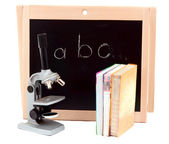 Blackboard with books — Stock Photo