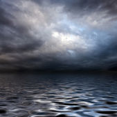 Torm sky over water surface — Stock Photo