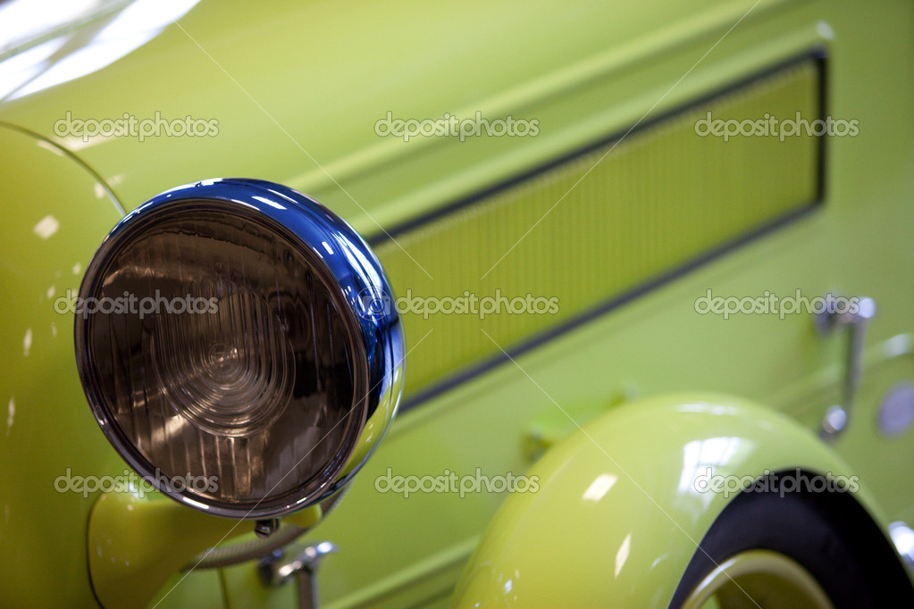 Fragment of a green old car with headlamp  Stock Photo #6055876