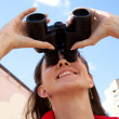Girl with binoculars and heart cloud - Stock Photo