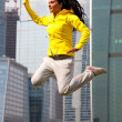 Brunette in a yellow blazer jumping — Stock Photo #6623194