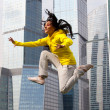 Girl in a tracksuit jumping — Stock Photo #6623208