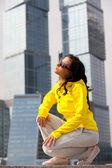 Brunette in a yellow blazer — Stock Photo