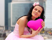 Girl doll with heart — Stock Photo