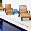 Chaise longues near pool — Stock Photo