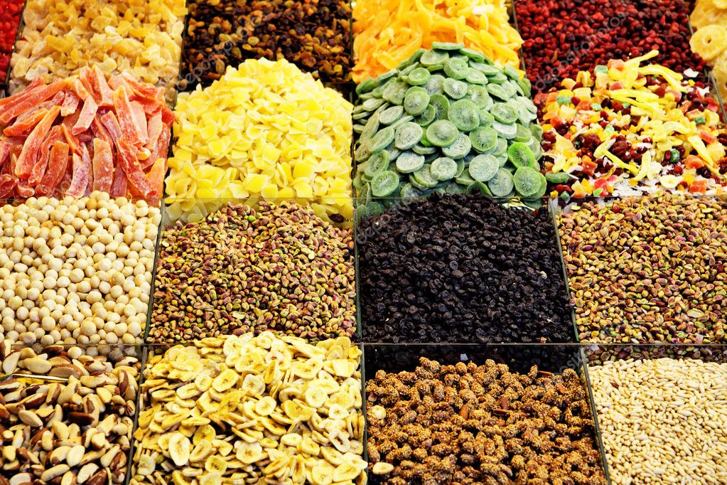 Market stall with various dried fruits and nuts — Stock Photo #5962749