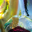 Royalty-Free Stock Photo: Bright colorful abstract background. Glass and drops of water.