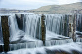 Water flowing over a dam — Stock Photo
