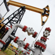 Pumpjack and oilwell. - Stock Photo