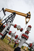 Pumpjack and oilwell. — Stock Photo