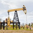 Stock Photo: Pump jack and oil well.