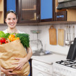 Stock Photo: Young beautiful caucasian woman in the kitchen