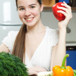 Young beautiful caucasian woman in the kitchen — Stock Photo #5680617