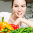 Young beautiful caucasian woman in the kitchen — Stock Photo #5680656
