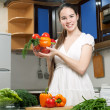 Young beautiful caucasian woman in the kitchen — Stock Photo #5680692