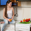Young beautiful caucasian woman in the kitchen — Stock Photo #5680704