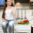 Young beautiful caucasian woman in the kitchen — Stock Photo #5680739