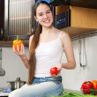 Young beautiful caucasian woman in the kitchen — Stock Photo #5680744