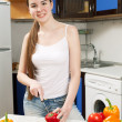 Young beautiful caucasian woman in the kitchen — Stock Photo #5680762