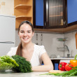 Young beautiful caucasian woman in the kitchen — Stock Photo