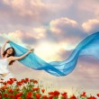 Stock Photo: Beauty woman in poppy field with tissue