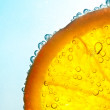 Orange in water bubbles - Stock Photo