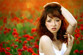 Woman closeup portrait in poppy field — Foto Stock