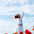 Royalty-Free Stock Photo: Beauty woman in poppy field