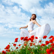 Beauty woman in poppy field — Stock Photo