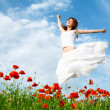 Beauty woman in poppy field — Stock Photo #5813398