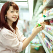 Stock Photo: Womshopping in supermarket