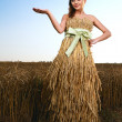 Woman in wheat field — Stock Photo #6015117