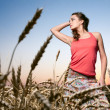 Woman in wheat field — Stock Photo