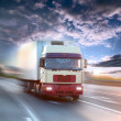 Truck on blurry asphalt road — Stok fotoğraf