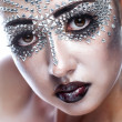 Beauty woman in futuristic makeup — Stock Photo