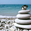 Balanced stones on the sea - Stock Photo