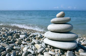 Balanced stones on the sea — Stock Photo