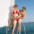 Man and woman on a yacht — Stock Photo