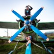 Crazy pilot with girlfriend — Stock Photo