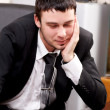 Young pensive businessman working in office — Stock Photo #5447576
