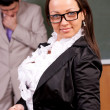 Portrait of attractive female teacher in a classroom — Stock Photo