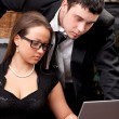 Businessman and businesswoman looking to laptop screen — Stock Photo