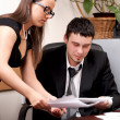 Stock Photo: Businessman and young female assistant working with documents