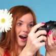 Stock Photo: Beautiful young female photographer