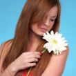 Cute young woman with white flower — Stock Photo