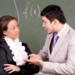 Young teacher and student in a classroom — Foto Stock