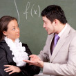 Young teacher and student in a classroom — Stock Photo