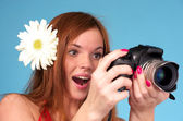 Beautiful young female photographer — Stock Photo